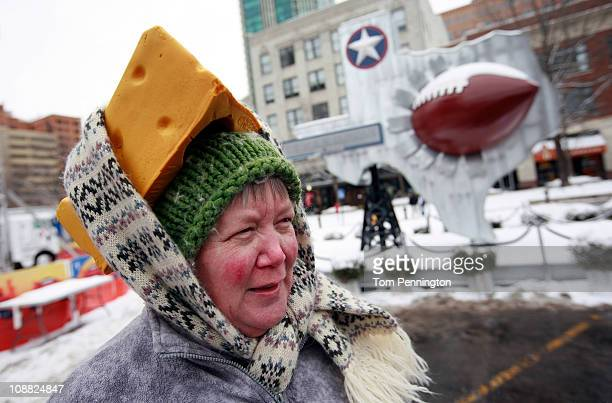 Caroline Fralia of Fort Worth Texas uses a scarf to secure her foam cheesehead hat in Sundance Square on February 4 2011 in Fort Worth Texas More...
