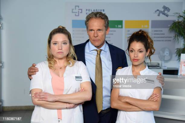 Caroline Frier Christian Tramitz and Anna Julia Antonucci attend a photocall during the filming of the new RTL sitcom Schwester Schwester Hier Liegen...