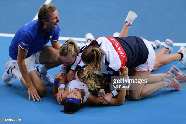Caroline Garcia and Kristina Mladenovic of France celebrate after winning the Women's doubles match against Ash Barty and Sam Stosur of Australia in...