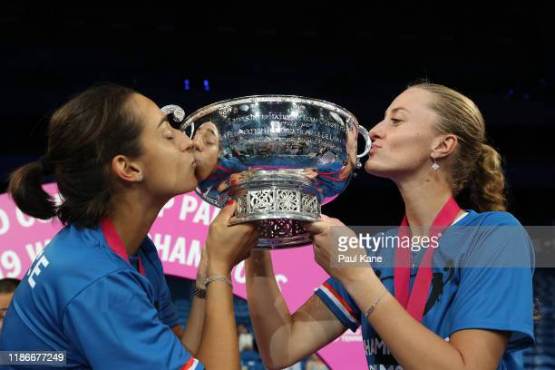 Caroline Garcia and Kristina Mladenovic of France kiss the Fed Cup after defeating Australia in the 2019 Fed Cup Final tie between Australia and...