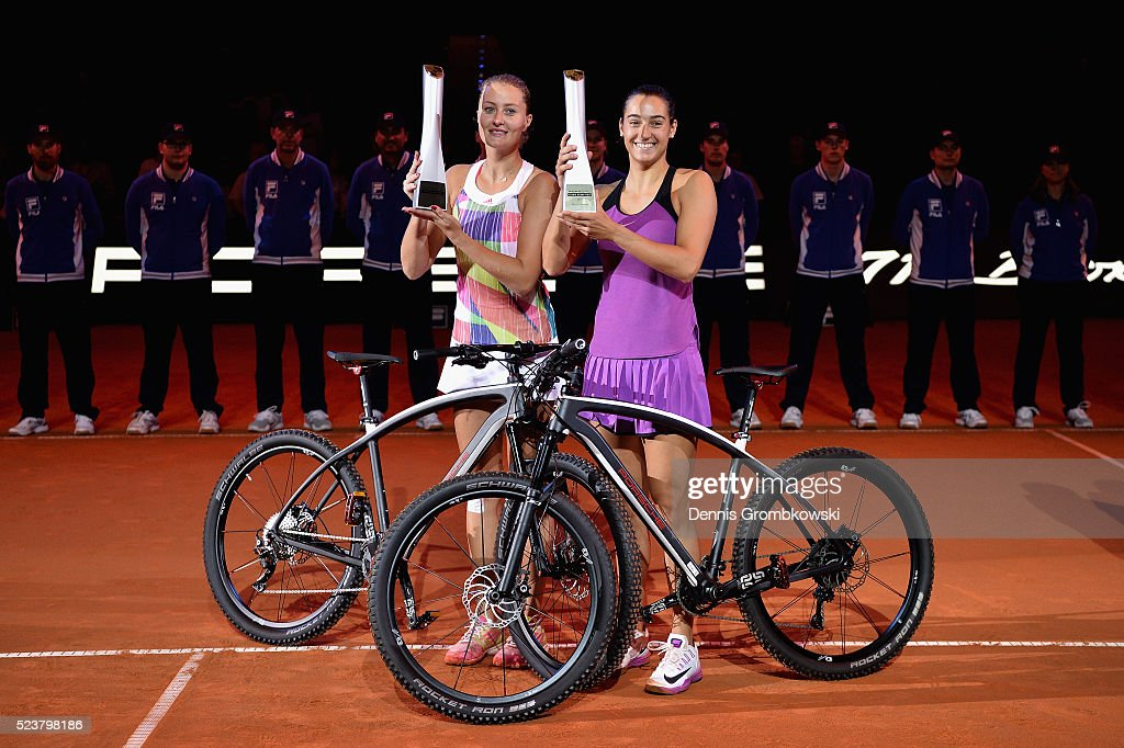Caroline Garcia and Kristina Mladenovic of France pose with their trophies after the doubles final against Martina Hingis of Switzerland and Sania Mirza of India on Day 7 of the Porsche Tennis Grand Prix at Porsche-Arena on April 24, 2016 in Stuttgart, Germany.