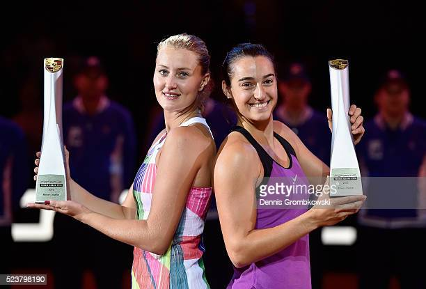 Caroline Garcia and Kristina Mladenovic of France pose with their trophies after the doubles final against Martina Hingis of Switzerland and Sania...
