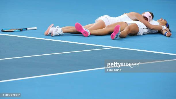 Caroline Garcia and Kristina Mladenovic of France talk celebrate winning the doubles match against Ash Barty and Sam Stosur of Australia and claiming...