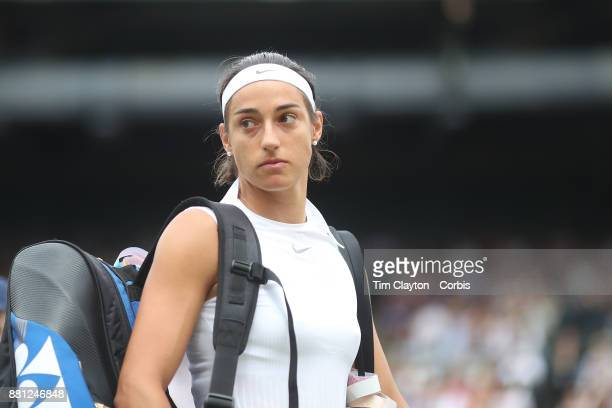 Caroline Garcia of France after her loss against Johanna Konta of Great Britain in the Ladies' Singles round of 16 on NO1 Court during the Wimbledon...