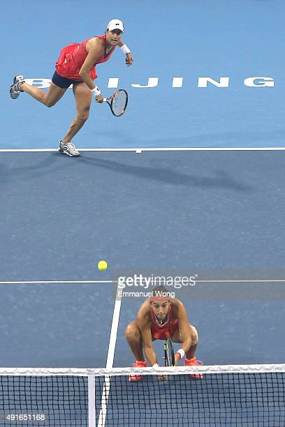 Caroline Garcia of France and Katarina Srebotnik of Slovenia serves against Chen Liang of China and Yafan Wang of China during the day five of the...