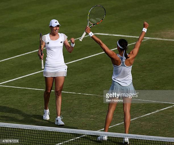 Caroline Garcia of France and Katarina Srebotnik of Slovenia celebrate winning the doubles final on day seven of the Aegon International at...