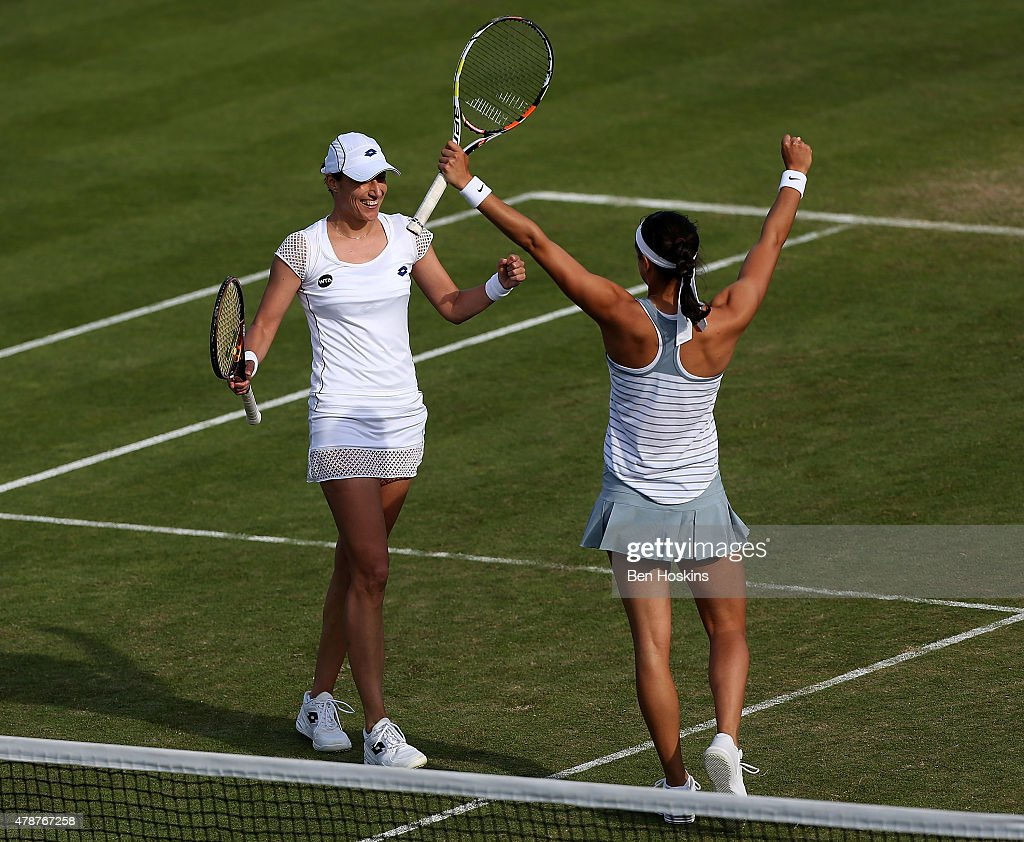 Caroline Garcia of France (L) and Katarina Srebotnik of Slovenia (R) celebrate winning the doubles final on day seven of the Aegon International at Devonshire Park on June 27, 2015 in Eastbourne, England.