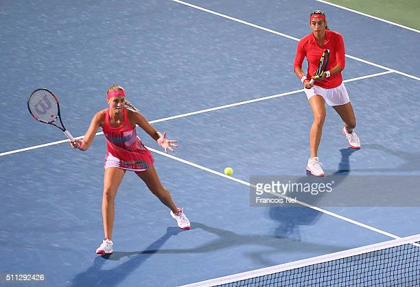Caroline Garcia of France and Kristina Mladenovic in action against Timea Babos of Hungary and Julia Goerges of Germany during their women's doubles...