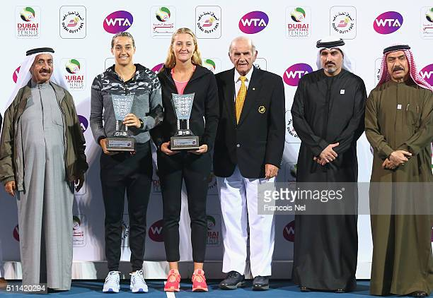 Caroline Garcia of France and Kristina Mladenovic of France holds the runner up trophy after the women's doubles final match of the WTA Dubai Duty...