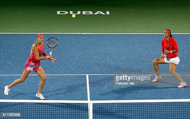 Caroline Garcia of France and Kristina Mladenovic of France in action against Timea Babos of Hungary and Julia Goerges of Germany during their...