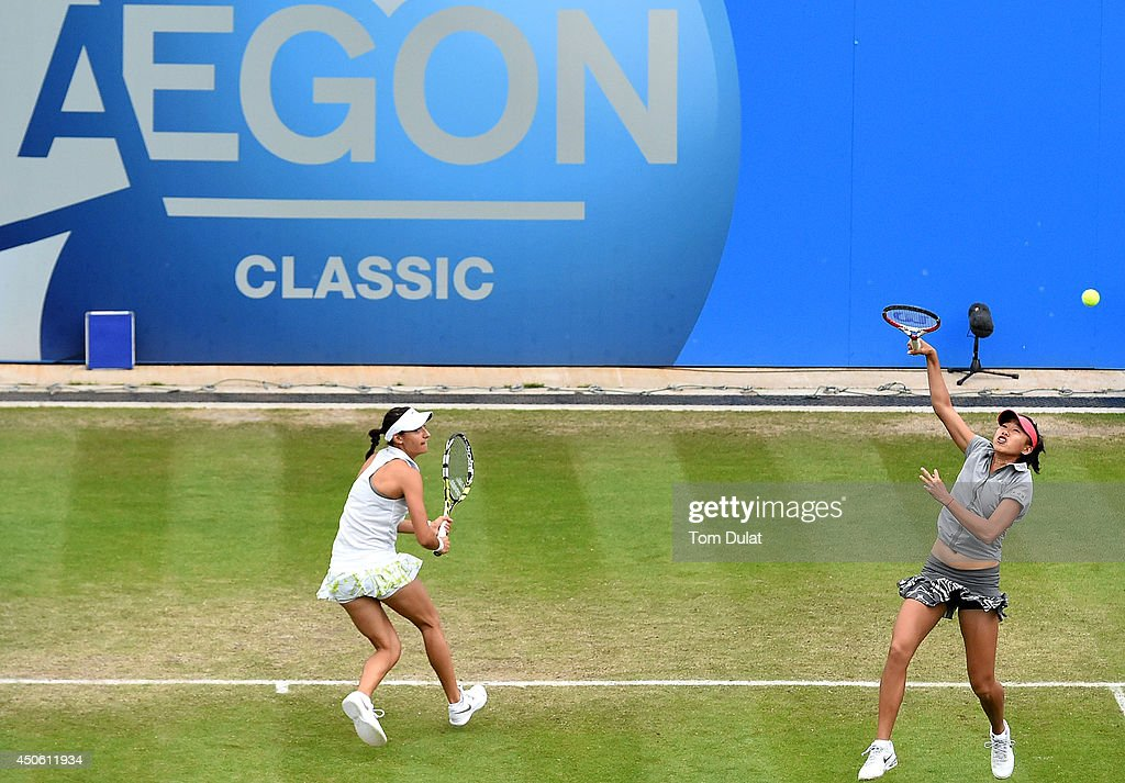 Caroline Garcia of France (L) and Shuai Zhang of China (R) in action against Casey Dellacqua and Ashleigh Barty of Australia on day six of the Aegon Classic at Edgbaston Priory Club on June 13, 2014 in Birmingham, England.