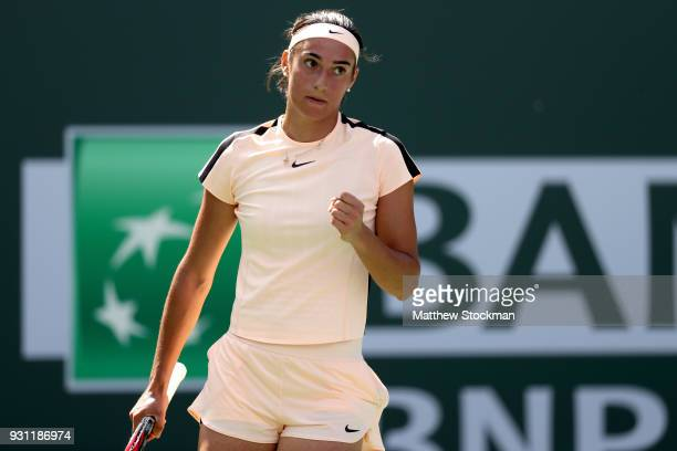 Caroline Garcia of France celebrates a point against Daria Gavrilova of Australia during the BNP Paribas Open at the Indian Wells Tennis Garden on...