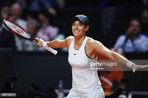 Caroline Garcia of France celebrates after defeating Maria Sharapova of Russia during day 2 of the Porsche Tennis Grand Prix at PorscheArena on April...