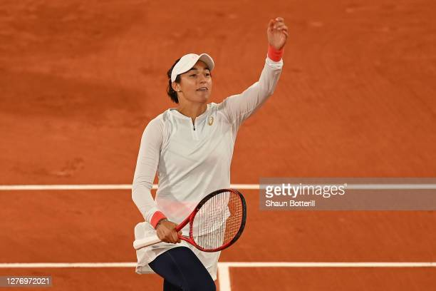 Caroline Garcia of France celebrates after winning match point during her Women's Singles first round match against Anett Kontaveit of Estonia during...
