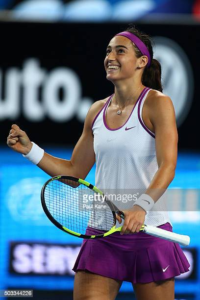 Caroline Garcia of France celebrates defeating Heather Watson of Great Britain in the womens singles match during day two of the 2016 Hopman Cup at...