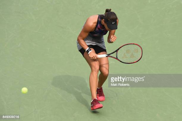 Caroline Garcia of France celebrates during her match against Aliaksandra Sasnovich of Belarus during day two of the Toray Pan Pacific Open Tennis At...