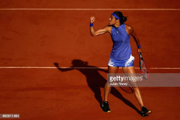 Caroline Garcia of France celebrates during ladies singles fourth round match against Alize Cornet of France on day nine of the 2017 French Open at...