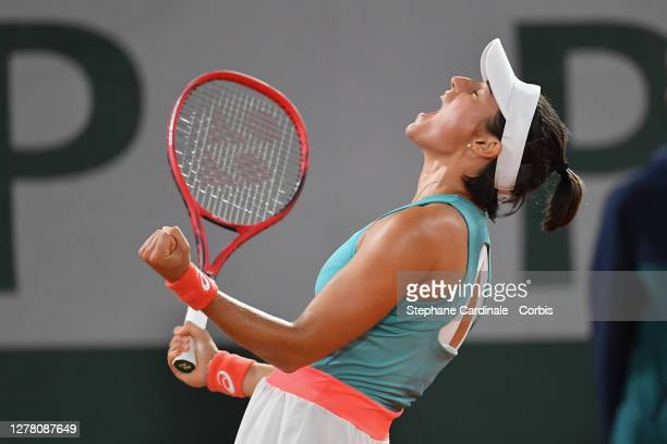 Caroline Garcia of France celebrates her three set victory against Elise Mertens of Belgium in front of a partisan crowd who join in the celebrates...