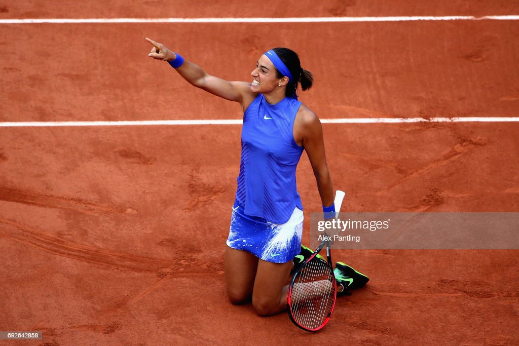 Caroline Garcia of France celebrates victory during ladies singles fourth round match against Alize Cornet of France on day nine of the 2017 French Open at Roland Garros on June 5, 2017 in Paris, France.