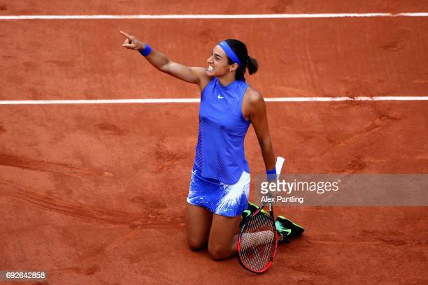 Caroline Garcia of France celebrates victory during ladies singles fourth round match against Alize Cornet of France on day nine of the 2017 French...