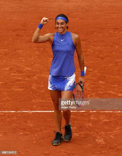 Caroline Garcia of France celebrates victory during the ladies singles first round match against Nao Hibino of Japan on day three of the 2017 French...