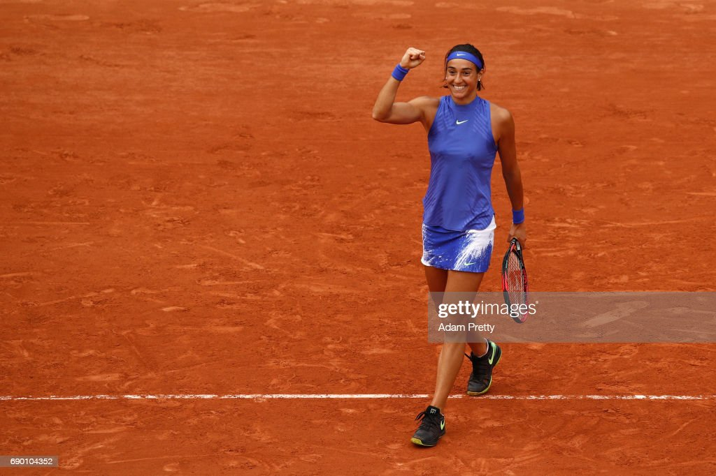 Caroline Garcia of France celebrates victory during the ladies singles first round match against Nao Hibino of Japan on day three of the 2017 French Open at Roland Garros on May 30, 2017 in Paris, France.