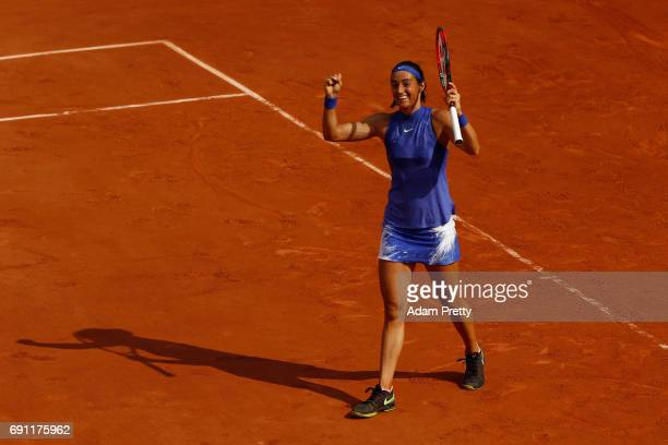Caroline Garcia of France celebrates victory during the ladies singles second round match against Chloe Paquet of France on day five of the 2017...