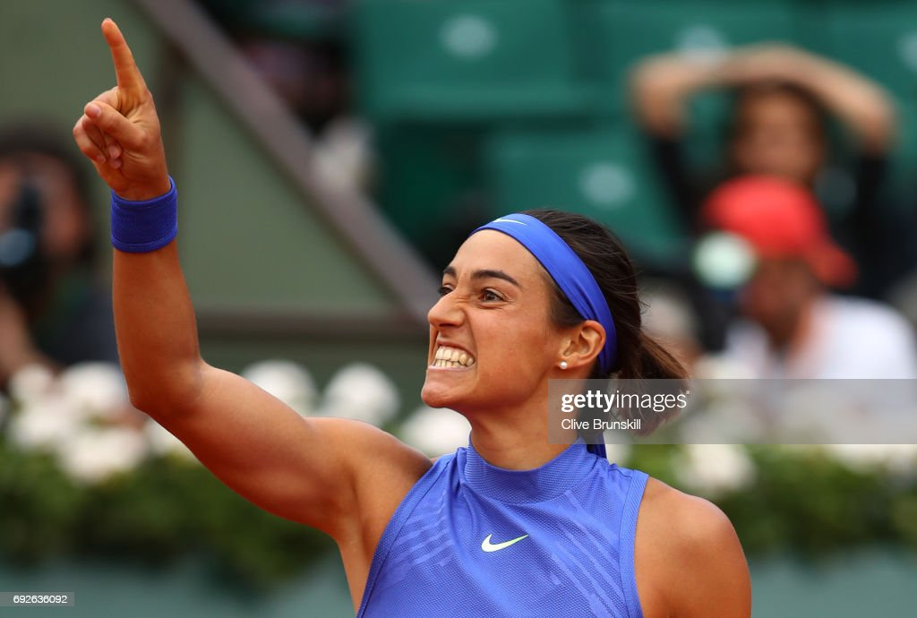 Caroline Garcia of France celebrates victory during the ladies singles fourth round match against Alize Cornet of France on day nine of the 2017 French Open at Roland Garros on June 5, 2017 in Paris, France.