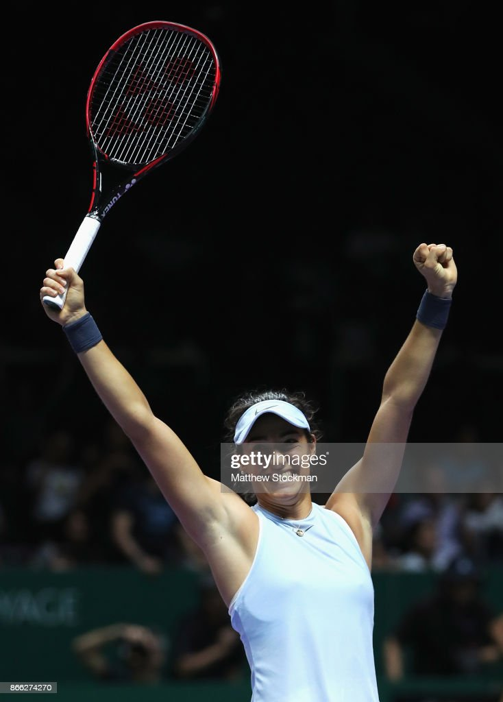 Caroline Garcia of France celebrates victory in her singles match against Elina Svitolina of Ukraine during day 4 of the BNP Paribas WTA Finals Singapore presented by SC Global at Singapore Sports Hub on October 25, 2017 in Singapore.