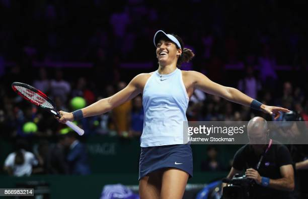 Caroline Garcia of France celebrates victory in her singles match against Caroline Wozniacki of Denmark during day 6 of the BNP Paribas WTA Finals...