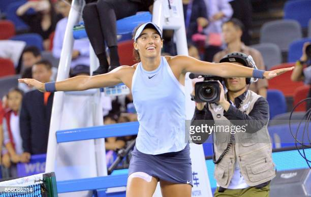 Caroline Garcia of France cerebrates after winning the ladies singles final against Ashleigh Barty of Australia on Day 7 of 2017 Dongfeng Motor Wuhan...