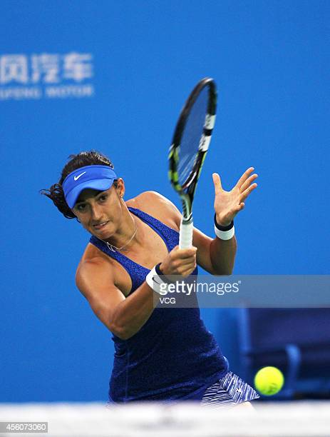 Caroline Garcia of France competes with Cara Black of Zimbabwe against Sara Errani of Italy and Roberta Vinci of Italy during day five of the 2014...
