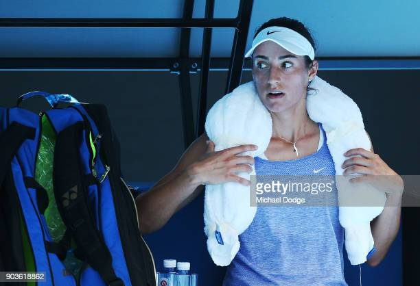Caroline Garcia of France cools down from the hot conditions with a wet towel during a practice session ahead of the 2018 Australian Open at...