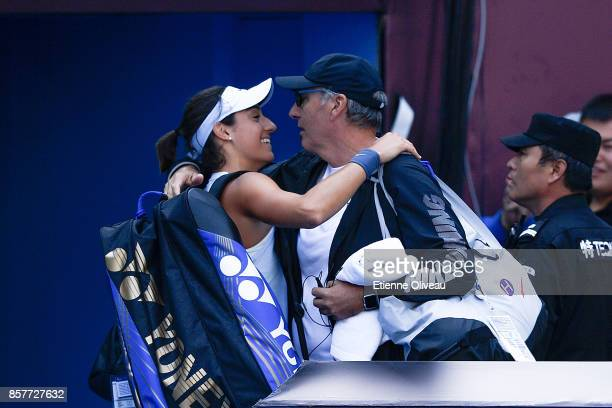 Caroline Garcia of France greets her coach after her Women's singles third round match against Alize Cornet of France on day six of the 2017 China...