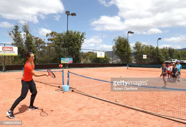 Caroline Garcia of France has a ht of tennis with local children during day one of the 2019 Hobart International at Domain Tennis Centre on January...