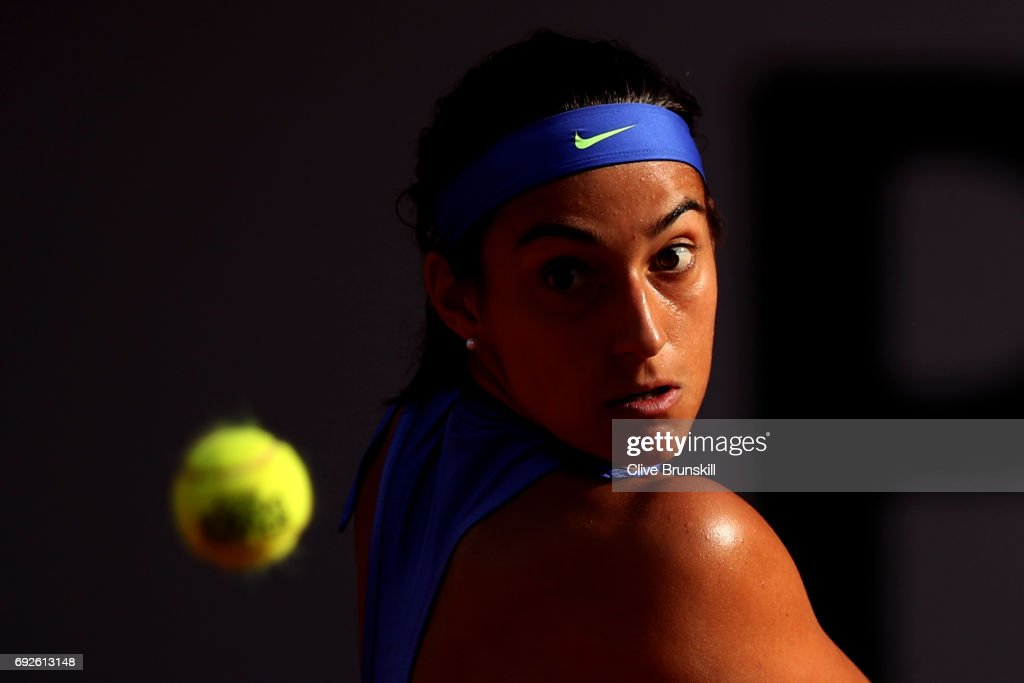 Caroline Garcia of France hits a backhand during the ladies singles fourth round match against Alize Cornet of France on day nine of the 2017 French Open at Roland Garros on June 5, 2017 in Paris, France.