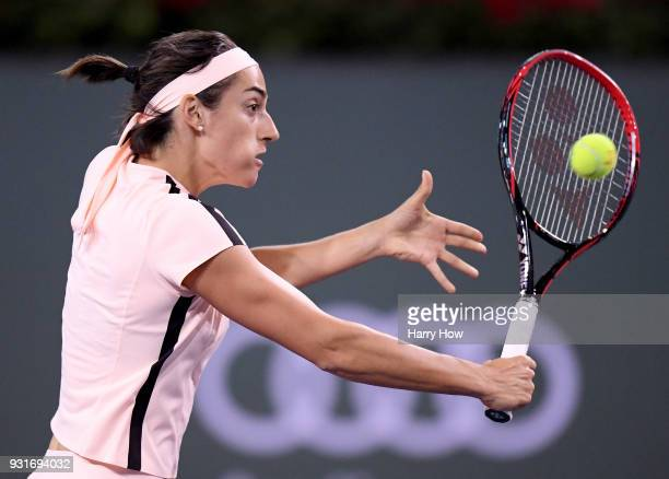 Caroline Garcia of France hits a backhand in her match against Angelique Kerber of Germany during the BNP Paribas Open at the Indian Wells Tennis...