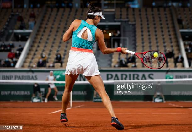Caroline Garcia of France hits a forehand against Elise Mertens of Belgium in the third round of the women's singles at Roland Garros on October 02,...