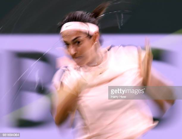 Caroline Garcia of France hits a forehand in her match against Angelique Kerber of Germany during the BNP Paribas Open at the Indian Wells Tennis...
