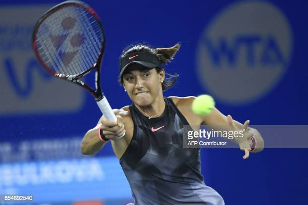 Caroline Garcia of France hits a return against Dominika Cibulkova of Slovakia during their third round women's singles match at the WTA Wuhan Open...