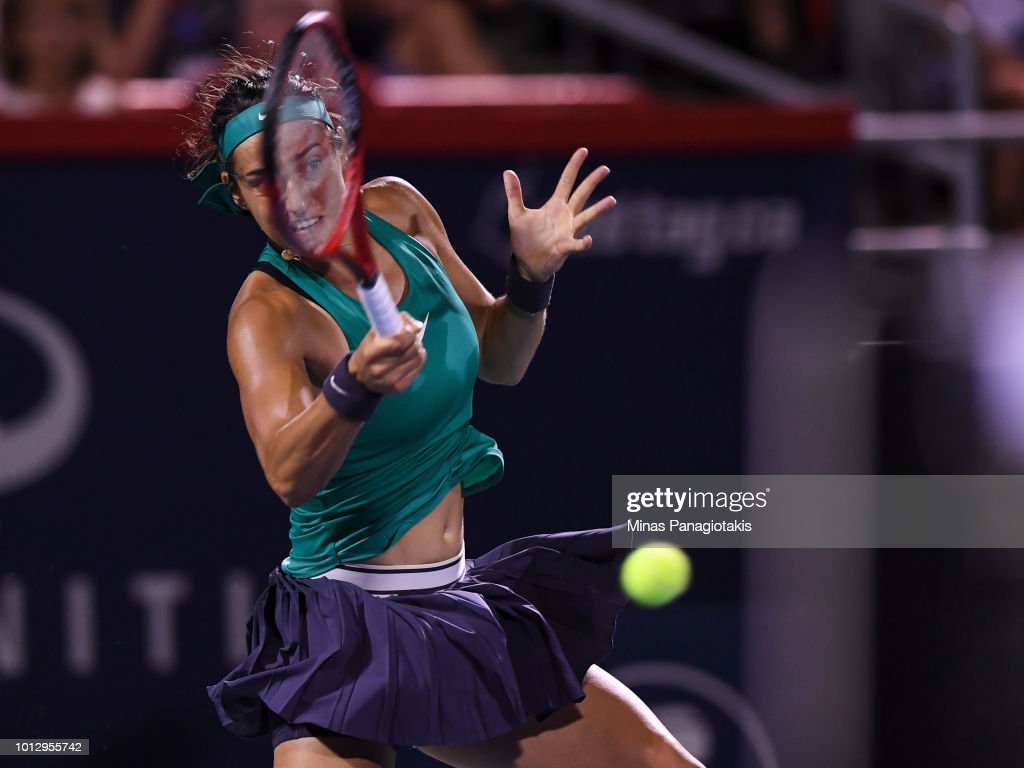 Caroline Garcia of France hits a return against Magdalena Rybarikova of Slovakia during day two of the Rogers Cup at IGA Stadium on August 7, 2018 in Montreal, Quebec, Canada.