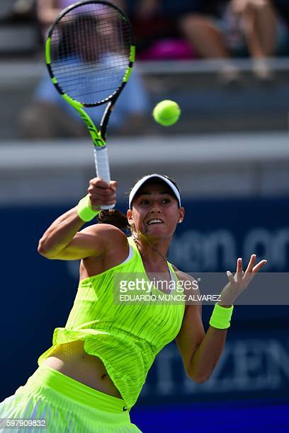 Caroline Garcia of France hits a return against Pauline Parmentier of France during their 2016 US Open Women's Singles match at the USTA Billie Jean...