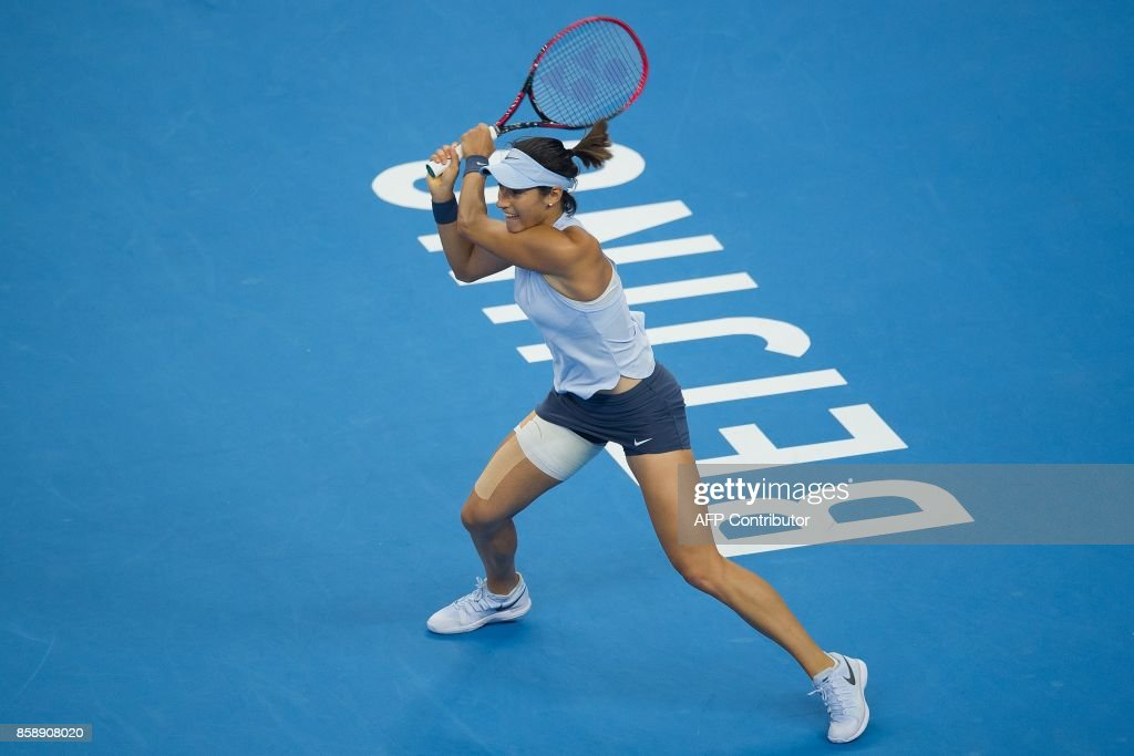 Caroline Garcia of France hits a return during her women's singles final match against Simona Halep of Romania at the China Open tennis tournament in Beijing on October 8, 2017. /