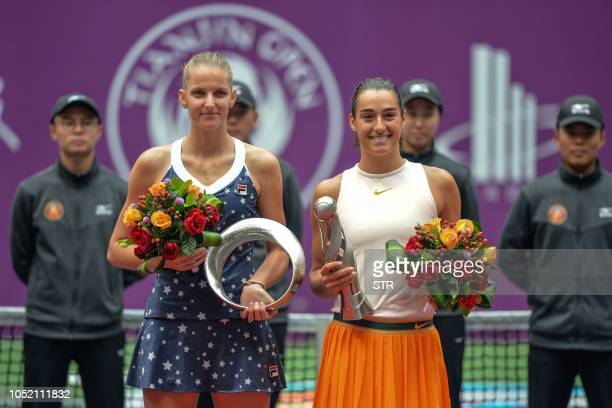 Caroline Garcia of France holds the trophy after winning the women's singles final match against Karolina Pliskova of the Czech Republic at the...