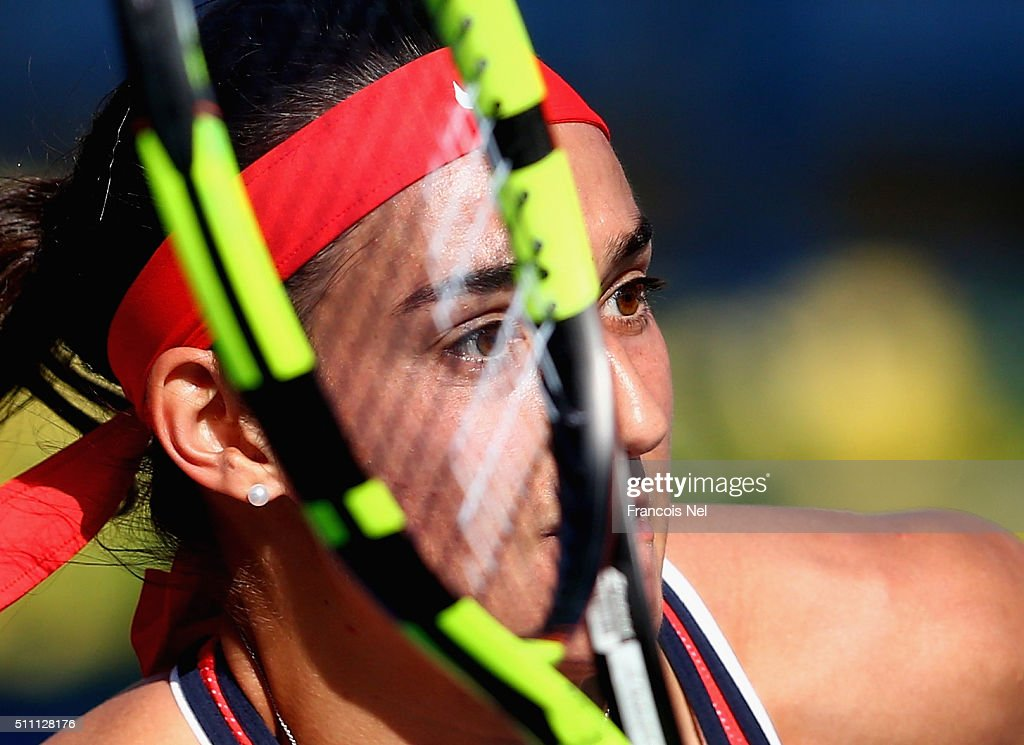 Caroline Garcia of France in action against Andrea Petkovic of Germany during day four of the WTA Dubai Duty Free Tennis Championship at the Dubai Duty Free Stadium on February 18, 2016 in Dubai, United Arab Emirates.