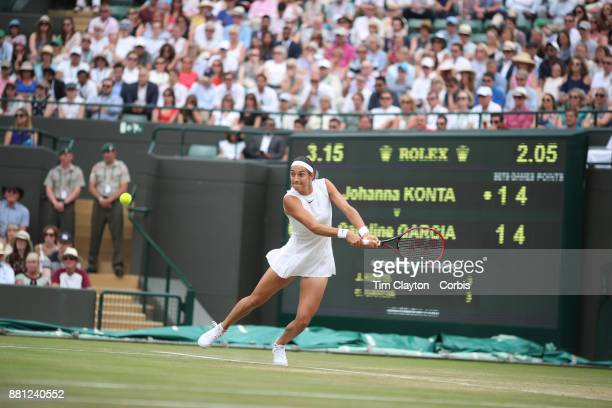 Caroline Garcia of France in action against Johanna Konta of Great Britain in the Ladies' Singles round of 16 on NO1 Court during the Wimbledon Lawn...