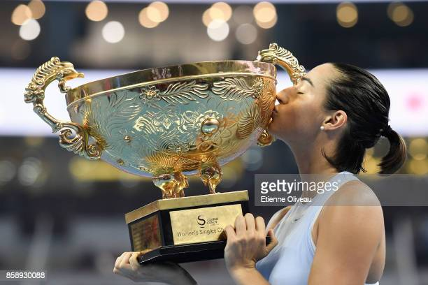 Caroline Garcia of France kisses the winners trophy after winning the Women's Singles final against Simona Halep of Romania on day nine of the 2017...
