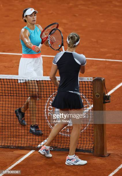 Caroline Garcia of France knocks racquets with Elise Mertens of Belgium at the net after their Women's Singles third round match on day six of the...