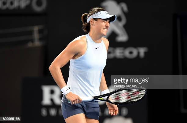 Caroline Garcia of France looks to grimmace in pain during her match against Alize Cornet of France during day one at the 2018 Brisbane International...