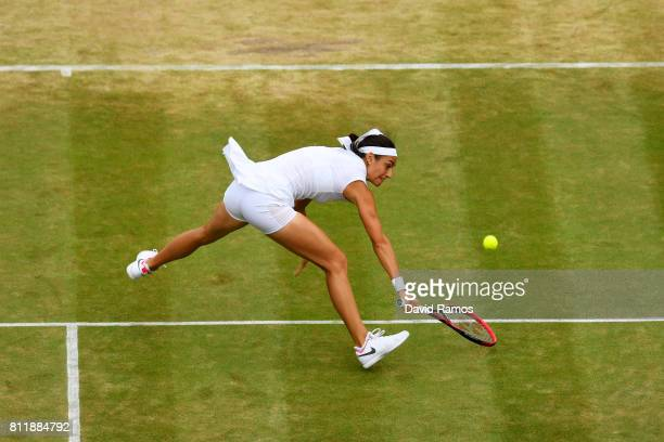 Caroline Garcia of France lunges for the ball during the Ladies Singles fourth round match against Johanna Konta of Great Britain on day seven of the...